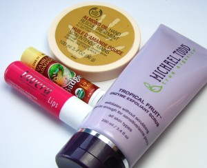 Lavera Naturkosmetik lip balm in Raspberry, Badger Lip Balm in Vanilla Madagascar, Michael Todd True Organics Tropical Fruit Enzymoe Exfoliant Scrub, The Body Shop Almond Oil Hand Rescue Treatment