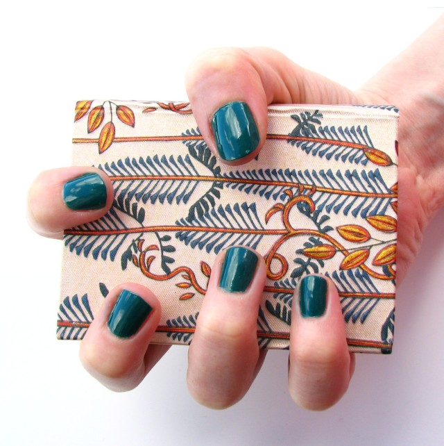 I was at a bit of a loss for jungle-y things to photograph with this manicure, but I think the design on the cover of this little book is perfect! It may or may not contain spells for getting rid of minor skin afflictions - you'll have to ask the wizard.